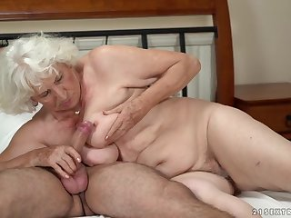 Horny granny gets her pussy serviced wits a young guy