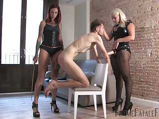 Two mistresses in latex outfits stock on strapon and pulp yoke submissive dude