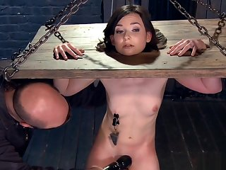 Chained and anal hooked brunette