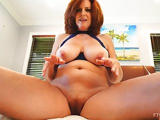 Busty redhead wife Andi drops her bra and panties to rag