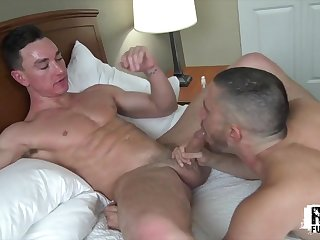 Hot gay guys make the bed bounce with intense lovemaking