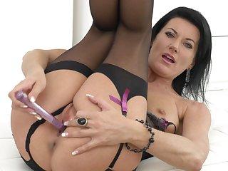 Naughty brunette Celine Noiret opens her legs to poke her holes