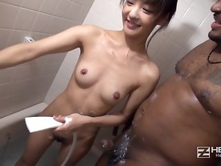 Puny boobed japanese doll satiates immense dark-hued boy after douche porn video